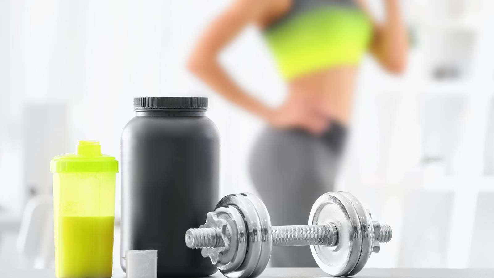 Fit patient with barbell and protein drinks